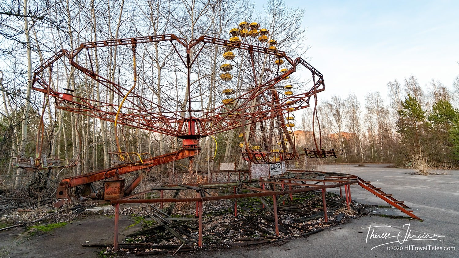 Amusement park rides sit near the Pripyat main square, rusted, falling apart and never to amuse children and adults.