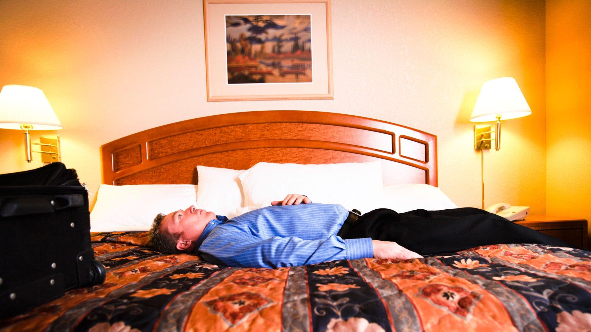Avoiding Jet Lag Man On Hotel Bed