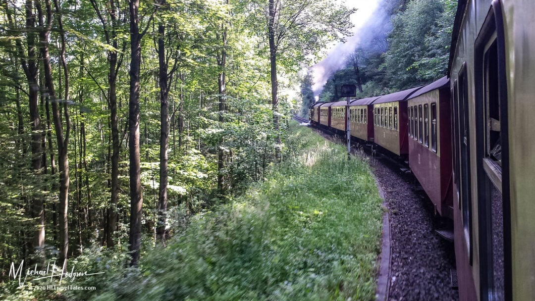 Brockenbahn Train Winds Through The Forest To The Summit Of The