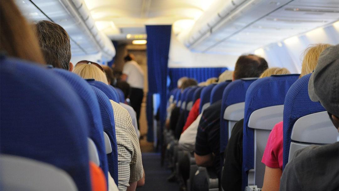Flying Sucks Inside Packed Airplane
