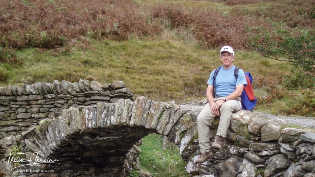 Michael Hodgson Sits On A Stone Bridge On A Hike Near Lake Winde
