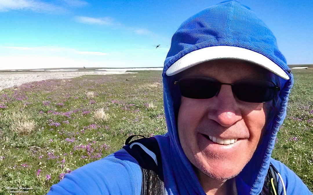 Grinning Under A Cloud Of Mosquitos In The Arctic National Wildl