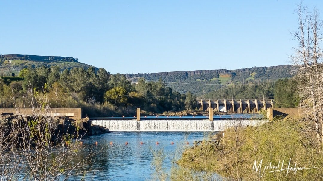 Oroville Dam And Fish Barrier From Feather River