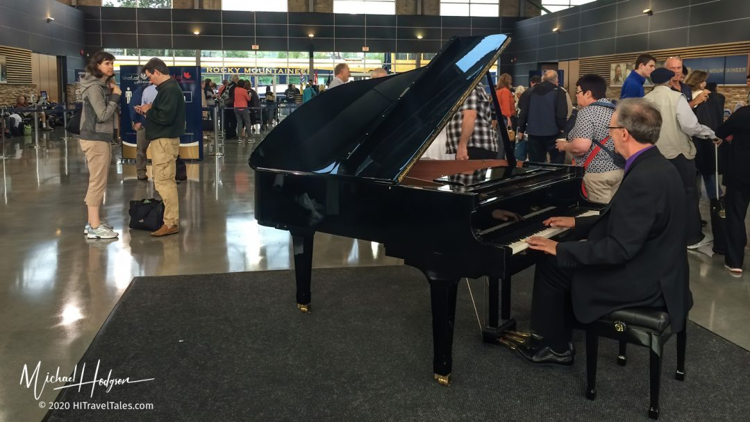 Piano Player Greets Customers Checking In For A Rocky Mountainee