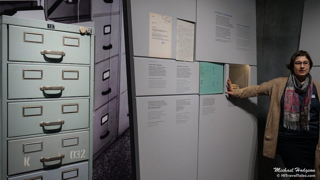 Stasi archives Berlin tour guide explains an exhibit