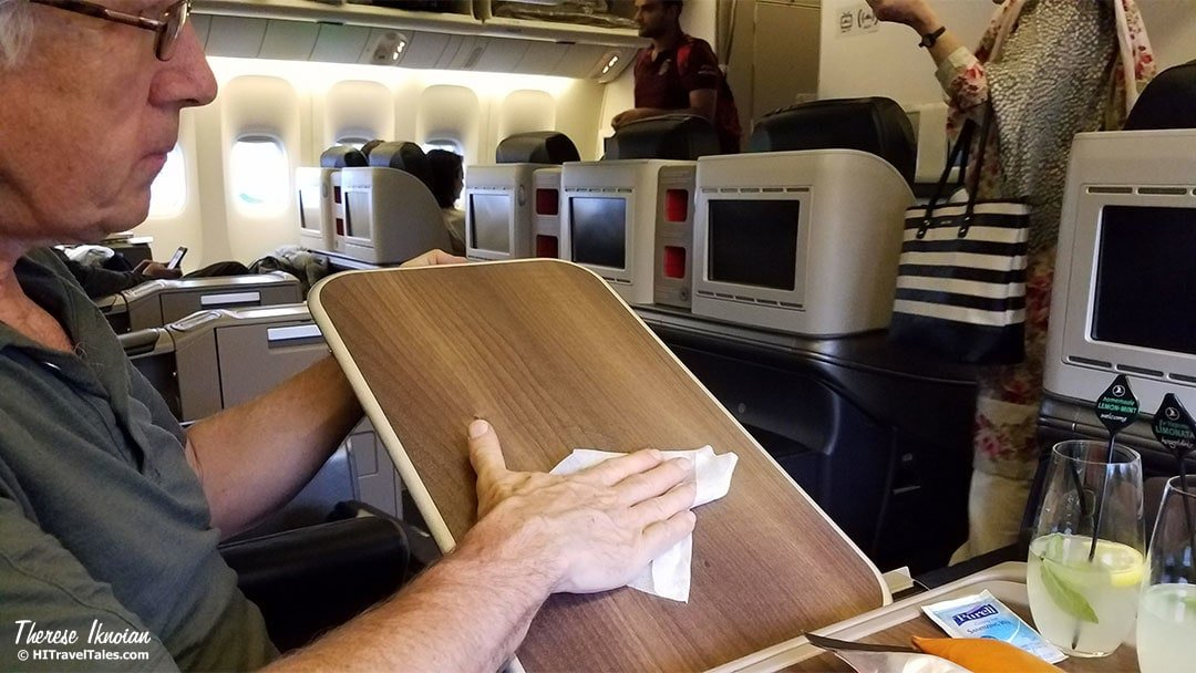 Staying healthy after air travel by wiping down your tray tables and more