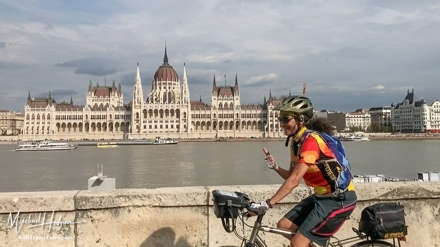 Therese Iknoian Pedaling By The Parliment Building In Budapest