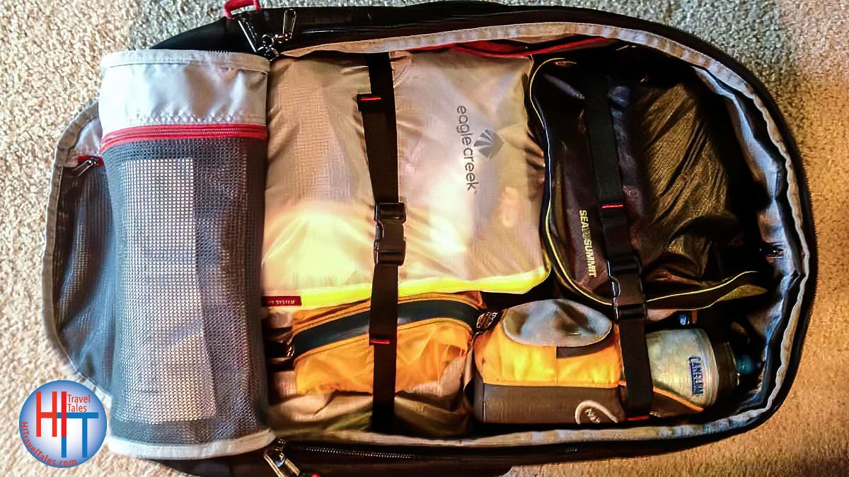 Travel Organization Tips. Luggage Showing Cube, Compress, Fold,
