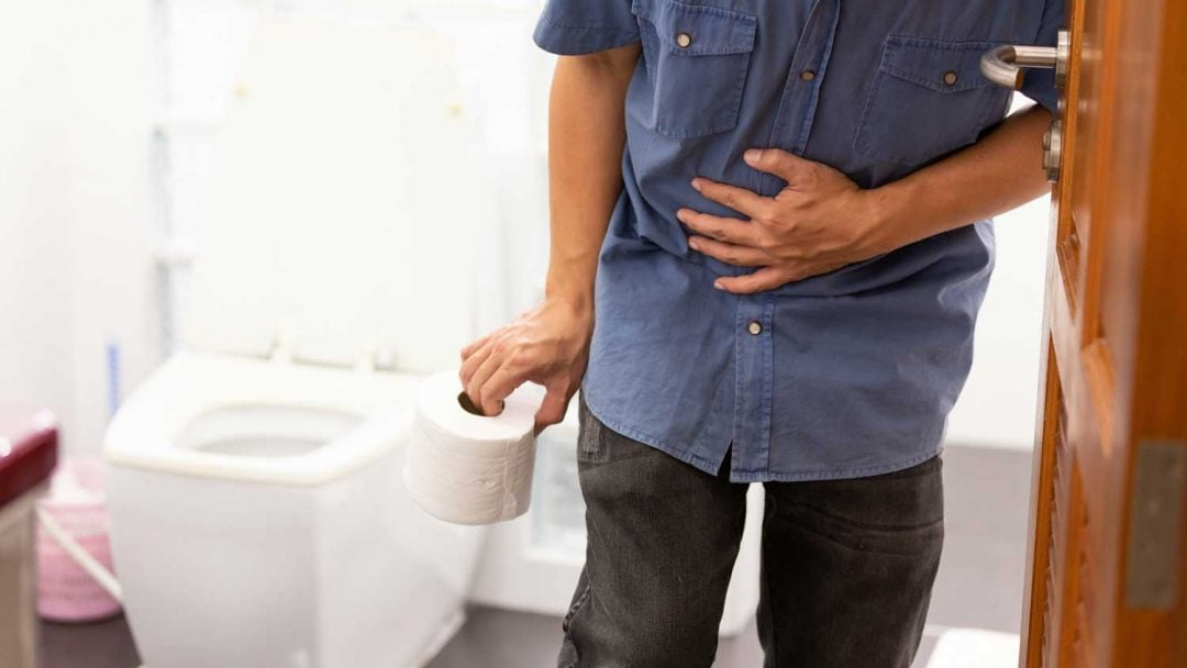 Travelers Diarrhea Man Holding Toilet Paper After Food Poisoning