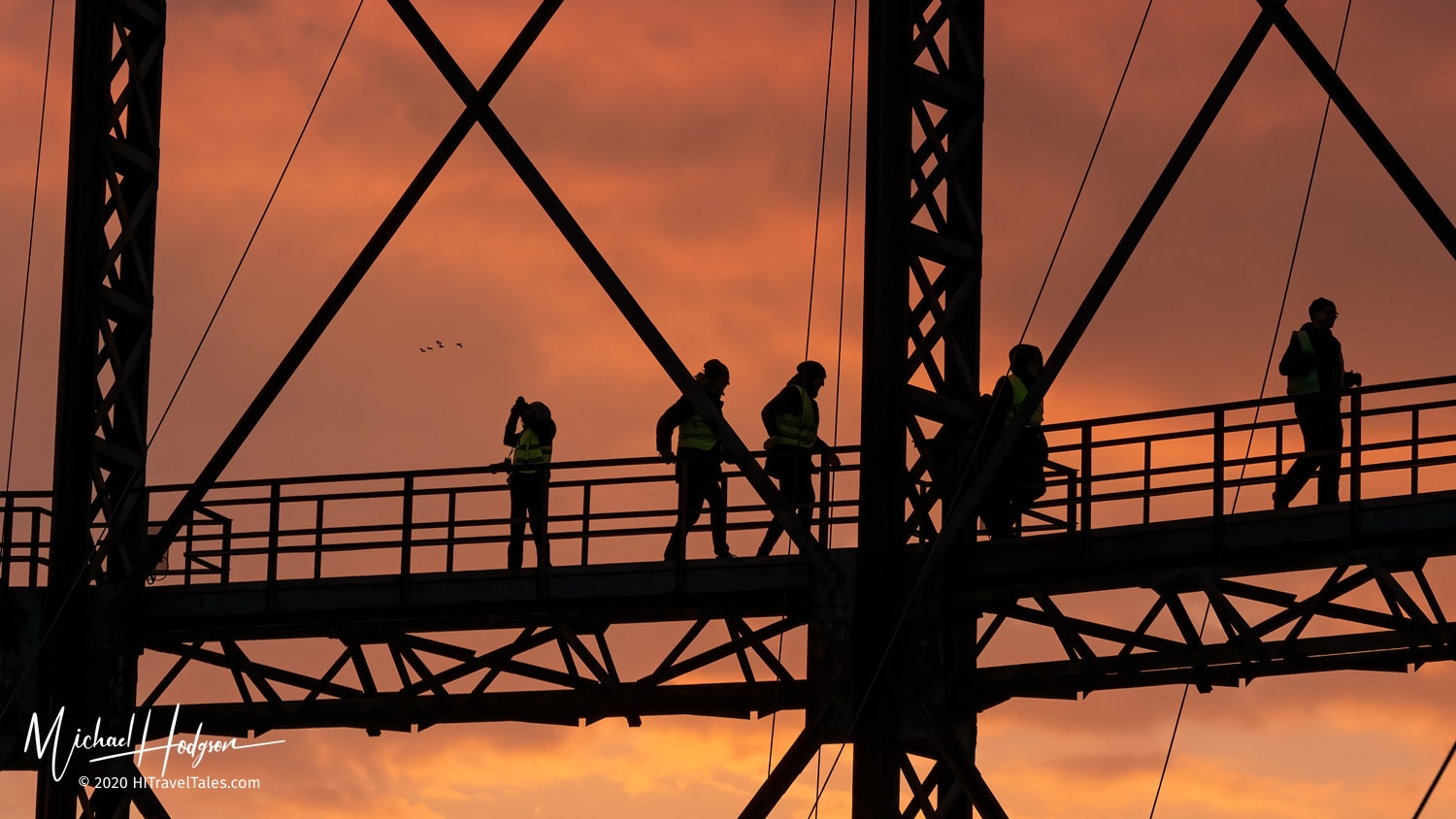 Silhouettes in the sunset on the catwalk of the gasometer.